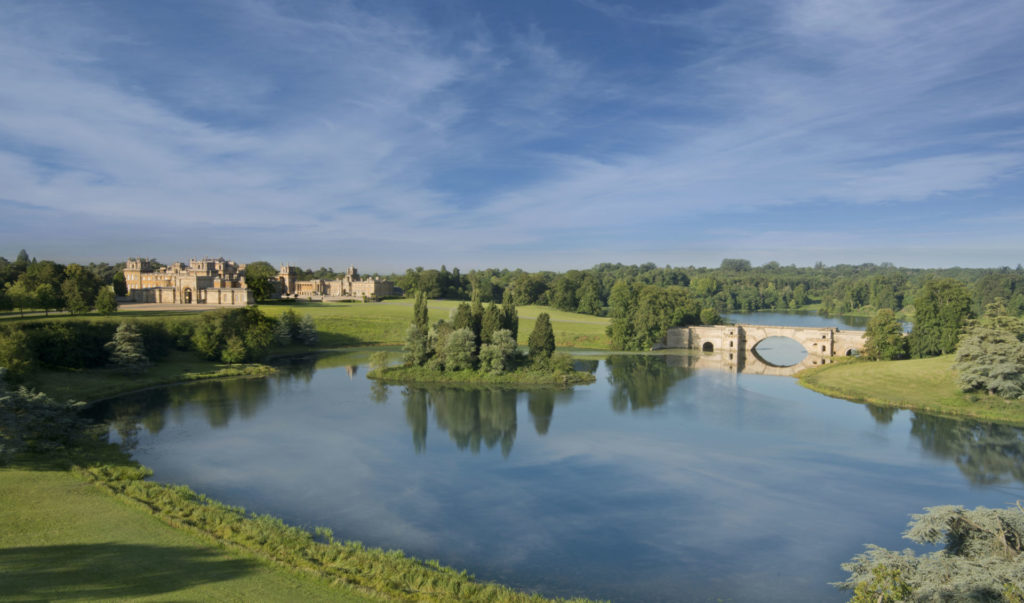 View across the lake with the Grand Bridge, the palace in the background. Grounds designed by Capability Brown.