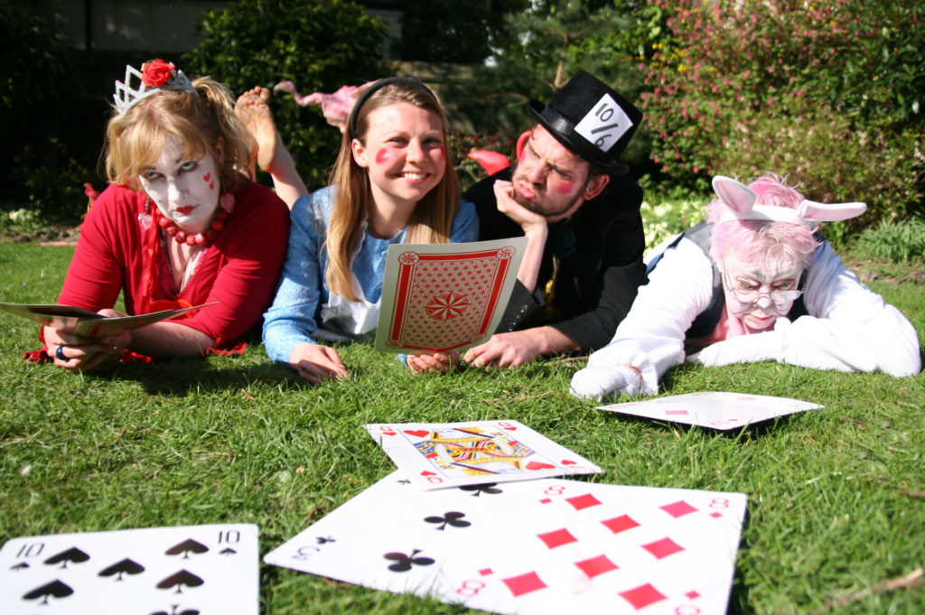 Costumed Characters on Alice Day, organised by the Story Museum. Girls dressed as characters from Alice in Wonderland by Lewis Carroll, a story strongly associated with Oxford.